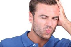 Man with headache Stock Photos