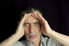 Man with a headache Stock Photo