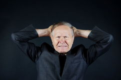 Man with headache. Angry businessman hands on head Stock Photo