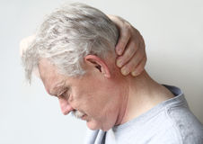 Man with headache at base of skull Stock Photos
