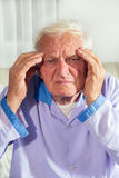 Man with headache in hospital Royalty Free Stock Photography