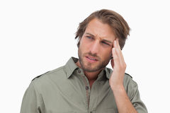 Man with headache looking away Royalty Free Stock Image