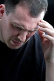 Man With Headache or Migraine Pain Royalty Free Stock Images