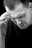 Man With Headache or Migraine Pain Stock Photo