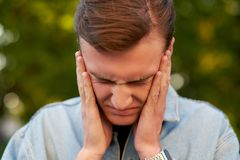 Man with headache, migraine or stress. Help, troubles in communication, overworking concept Stock Images