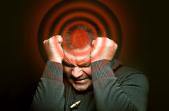 Man with a headache. Portrait of a man with a excruciating headache stock images