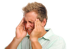 Man with headache in studio Royalty Free Stock Photo
