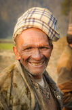 Man with headcloth in Nepal. Dolpo, Nepal - circa May 2012: Old native man with wrinkles wears brown headcloth in Dolpo, Nepal. Documentary editorial Stock Image