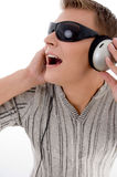 Man with headphone and sunglasses Stock Photos