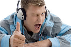 Man with headphone wishing good luck. With white background Royalty Free Stock Photo