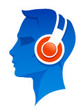Man with headphones. Blue head of a man in profile wearing headphones Royalty Free Stock Photos