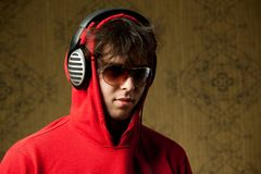 Man in headphones. An image of a young man listening to music in headphones royalty free stock images