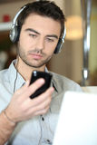 Man with headphones Stock Images