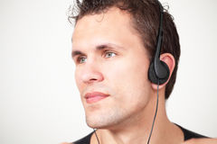 Man on headphones Stock Image