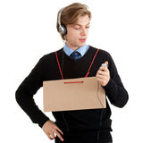Man in headphones and blank card Stock Photography