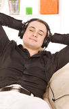 Man in headphones Stock Images