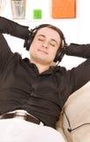 Man in headphones Stock Images