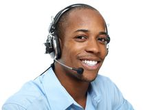 Man with headphones. Call center operator. Speaking with client Stock Images