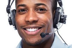 Man with headphones. Call center operator. Speaking with client Royalty Free Stock Photo
