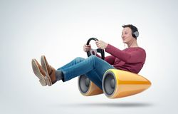 Man with headphones car driver with a steering wheel and bass speaker, concept of sound in motion.  stock image