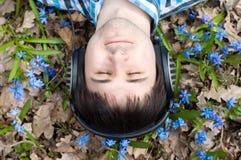 Man in headphones. Flowers. Spring Royalty Free Stock Image