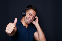 Man with headphones on his ears and making ok sign Royalty Free Stock Image
