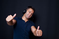 Man with headphones on his ears and making ok sign Stock Photos