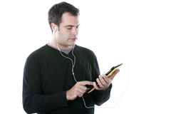 Man with headphones, holding a tablet Royalty Free Stock Image