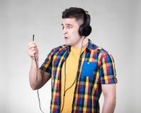 Man with headphones jack Stock Photo