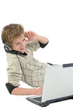 Man with headphones and laptop Stock Image