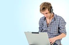 Man with headphones and laptop Royalty Free Stock Photography
