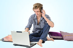 Man with headphones and laptop Royalty Free Stock Photos