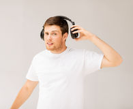 Man with headphones listening loud music stock images