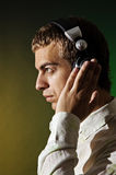 Man in headphones listening the music Royalty Free Stock Images