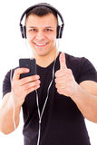Man with headphones listening music on mp3 player Stock Image