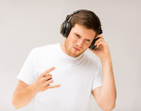 Man with headphones listening rock music Royalty Free Stock Photo
