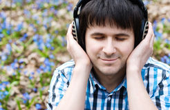 Man in headphones listening to music. Royalty Free Stock Photo
