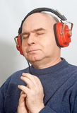 Man with headphones listening to music Stock Image