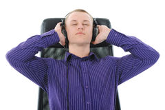 Man with headphones listening to music. Isolated on white background Stock Photo