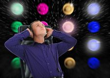 Man with headphones listening to music. Image of a  man with headphones listening to music Stock Photography