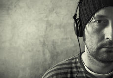 Man with headphones listening to music Stock Images