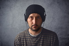 Man with headphones listening to music Royalty Free Stock Image