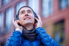 Man in headphones listening to music Royalty Free Stock Photography