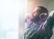 Man in headphones listening to music Stock Images