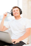 Man with headphones listening to music Stock Photos