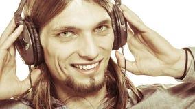 Man with headphones listening to music. Leisure. Stock Photos