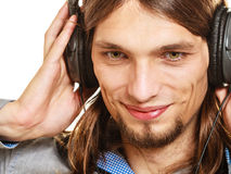 Man with headphones listening to music. Leisure. Stock Images
