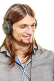 Man with headphones listening to music. Leisure. Stock Photography