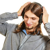 Man with headphones listening to music. Leisure. Stock Photo