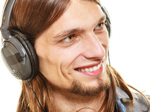Man with headphones listening to music. Leisure. Royalty Free Stock Photography